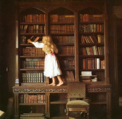 child reaching for book.jpg